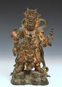 a statuette of Kuan-Ti