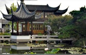 A traditional Chinese garden with pavilions and a pond