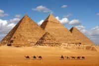 Four pyramids against a blue sky