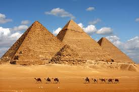 Four pyramids against a blue sky - these all have straight sides and no steps