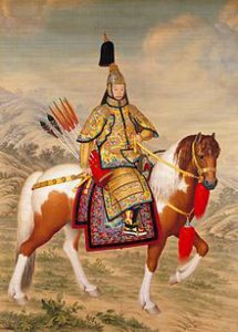 Chinese man in golden armor on a horse: the Qianlong Emperor