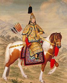 Chinese man in golden armor on a horse