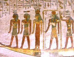The sun god Ra on his solar boat, traveling across the sky from east to west.