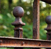 a rusty fence railing - oxidation reaction