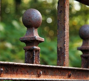 a rusty fence railing - oxidation reaction