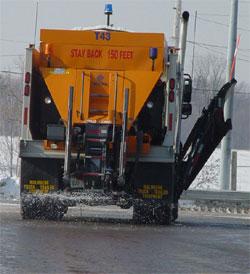 A salt truck spreading salt on the road