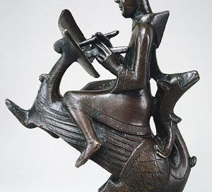 Monk writing a book, seated on a wyvern (North Germany, ca. 1150 AD now in Metropolitan Museum, NYC)