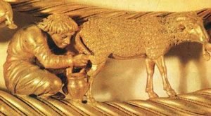 Scythian man milking a sheep in gold, part of a necklace