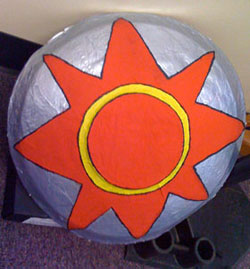 A Roman shield model with a big red star painted on it