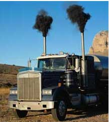 a truck with black smoke coming out of two pipes