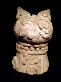 Sumerian clay head of a cat, maybe wearing a collar