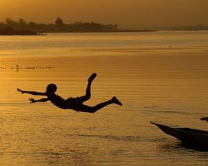 Boy swimming in the Niger river, West Africa