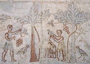 Two men picking dates (Basra Theater, Roman Syria, ca. 150 AD)