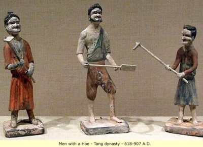 three little clay figures; two hold hoes and one holds a shovel. They're good examples of medieval Chinese clothing: one wears a bright red knee-length tunic and has his hair in a bun. He is clean-shaven. One wears a knee-length blue tunic and a maroon jacket. His hair is the same. The third man wears tan pants and a white shirt, with a blue overshirt over one shoulder. He has a short beard.
