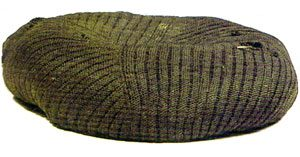 a brown beret from Central Asia made of nalbinding