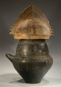 Villanovan cremation urn with helmet on top (ca. 900 BC)