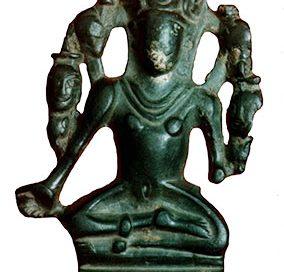 A small green stone statue of Vishnu