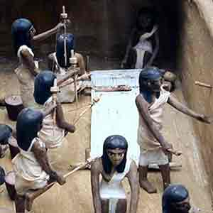 Egyptian women spinning and weaving (Model from the Tomb of Meket-re in Luxor, 11th dynasty (ca. 2000 BC), now in the Egyptian Museum, Cairo)
