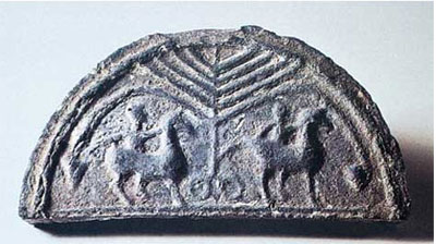 A semi-circular roof tile with two men riding horses on it