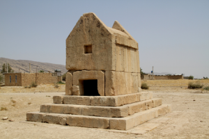 A small stone building on a raised platform - Persian tomb