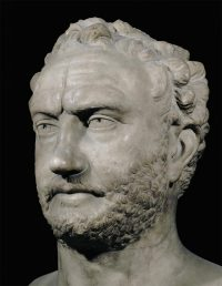 Thucydides: a stone bust of a middle-aged white man with a short beard