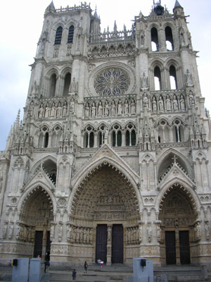 A large stone building with fancy carving and pointed arches all over it - medieval cathedrals
