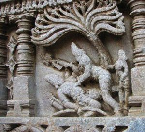 Arjuna fights Shiva (in a story from the Mahabharata) - white stone carving of two men fighting