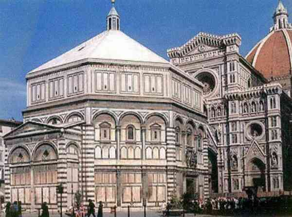 An octagonal building with green, red,and white marble patterning. Florence baptistery