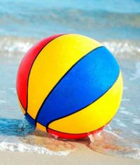A beach ball in the sand.
