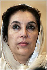 Benazir Bhutto: a middle eastern woman in a white head covering