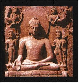 A clay image of the Buddha sitting in the lotus position with his palm out - Buddhism in India