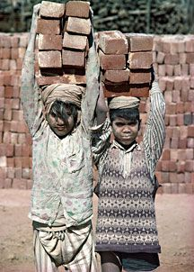 Children working in a brick factory in what is now Pakistan