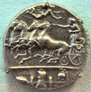 A Syracusan coin made to celebrate their victory over Athens, showing a chariot with a fish tail