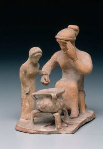 A woman and a girl cooking