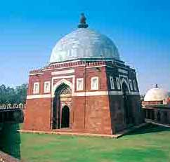 Tomb of a Tughluq sultan: a square red brick building with a white dome
