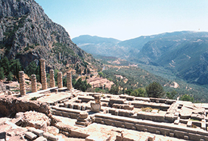 Ruined stone temple on a mountainside with a great view - The temple of the god Apollo