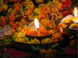 Diwali lamp: a candle flame surrounded by flowers