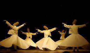 Sufi dancers in big white skirts spinning around