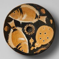 Platter with fish painted on it