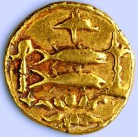 A gold coin with fish on it.