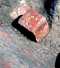 A die found in excavations at a Harappan period site. Note that thesix is not opposite the one.