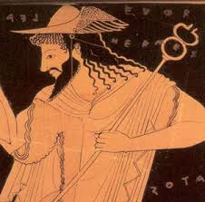 Hermes often wears a traveller's hat and carries a caduceus, his twisted stick. Here on a red figure vase.
