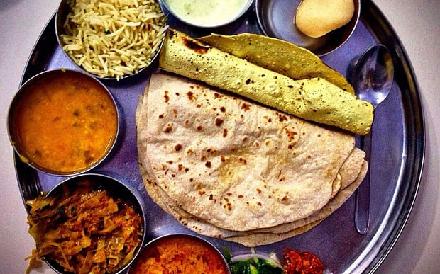 Indian food: rice, chapatis, sauces, lentils