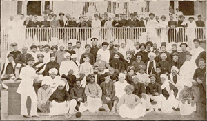 An old photo of a large group of indian men including Gandhi