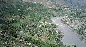 Indus river flowing along green hills