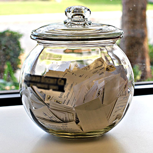 A shiny silver jar