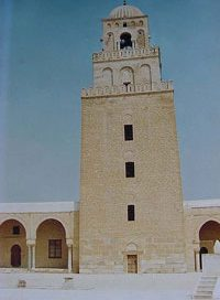 Kairouan's minaret - a tower with one small window in the center of each story