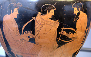 A lyre lesson (the teacher has a beard)
