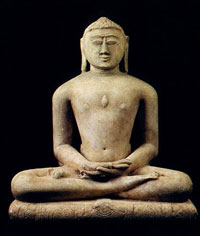 A Jain statue, possibly Mahavira, from about 1200 AD: an Indian man sitting cross-legged