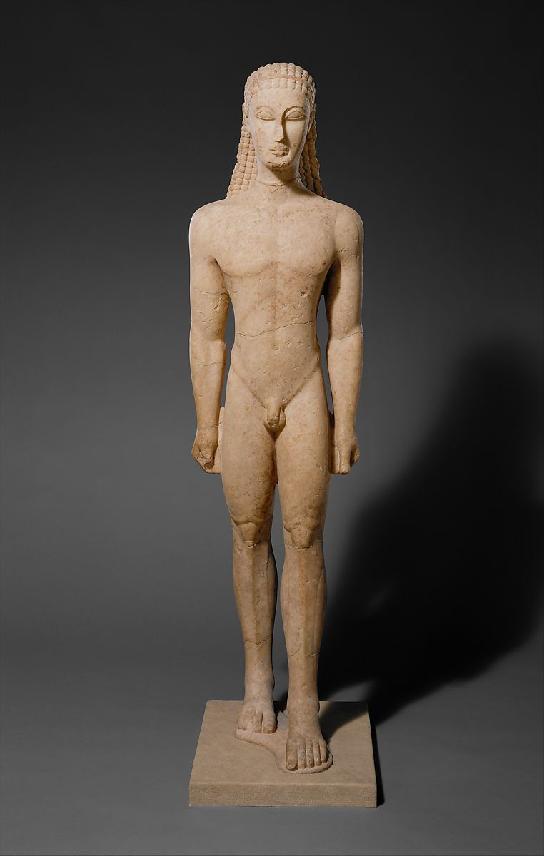 stone statue of a standing naked man